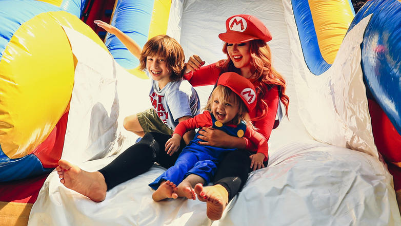 BEVERLY HILLS, CA - AUGUST 20:  (NO TABLOIDS&#x3B; NO BAUER MEDIA) (EDITORS NOTE: This image has been retouched.)  Singer Christina Aguilera (R), her daughter Summer Rain Rutler (C) and son Max Liron Bratman smile and laugh as they slide down the play sli