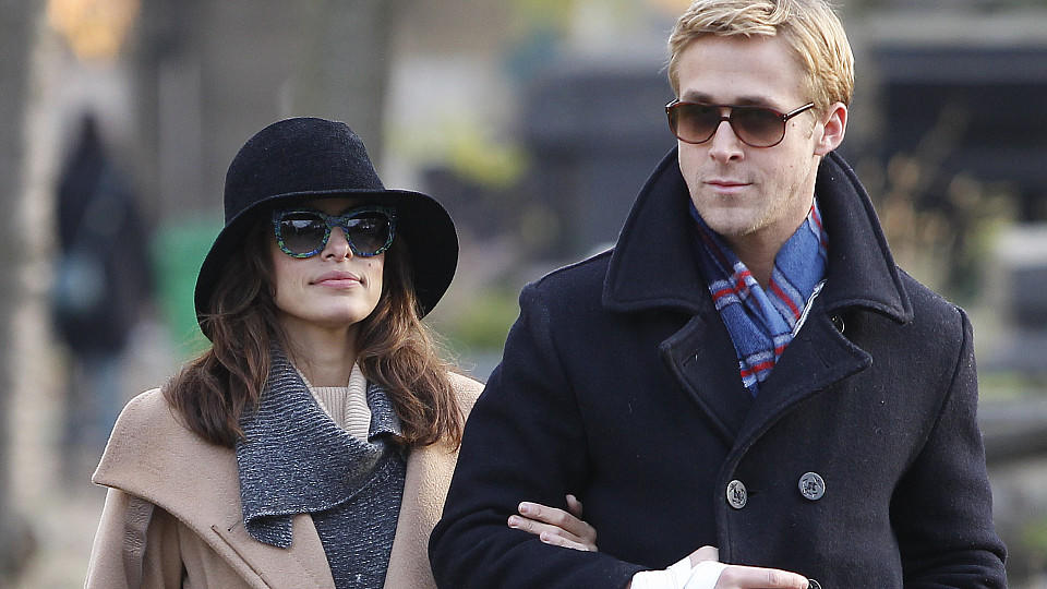 Eva Mendes and Ryan Gosling having a romantic walk through Pere Lachaise cemetery in Paris, among illustrious people's gravestones such as Chopin, Modigliani, Edith Piaf, Oscar Wilde and Jim Morrison.