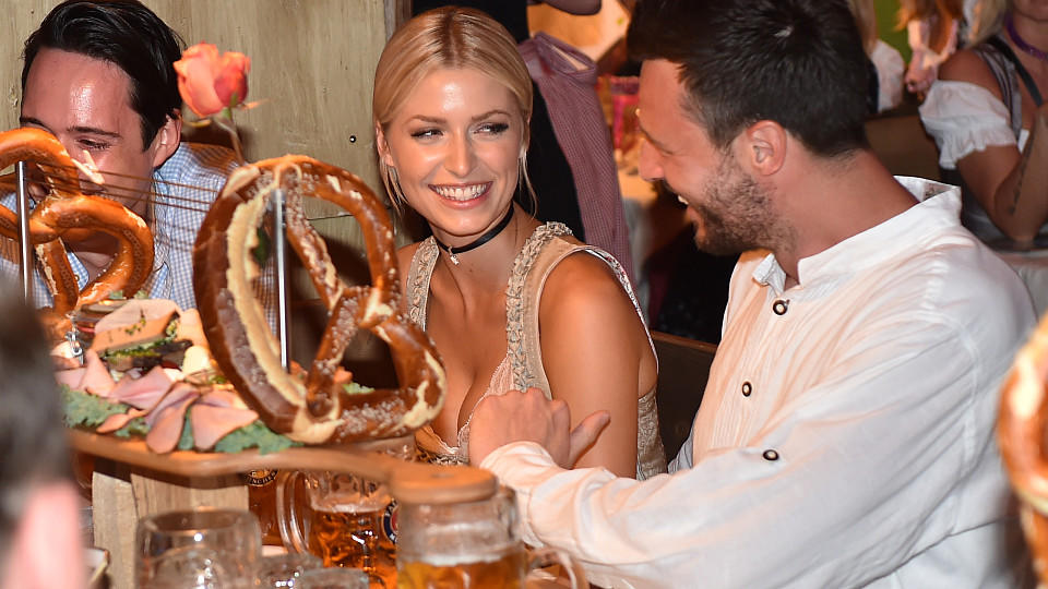 MUNICH, GERMANY - SEPTEMBER 24:  Model Lena Gercke and partner Kilian Mueller-Wohlfahrt in the Kaeferschaenke beer tent during the Oktoberfest at Theresienwiese on September 24, 2016 in Munich, Germany.  (Photo by Hannes Magerstaedt/Getty Images)