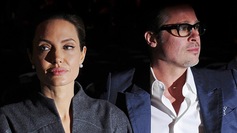 epa05549315 (FILE) The file picture dated 13 June 2014 shows US actress Angelina Jolie (L) and US actor Brad Pitt (R) arriving for the Global Summit to End Sexual Violence in Conflict at the Excel Center in London, Britain. According to media reports