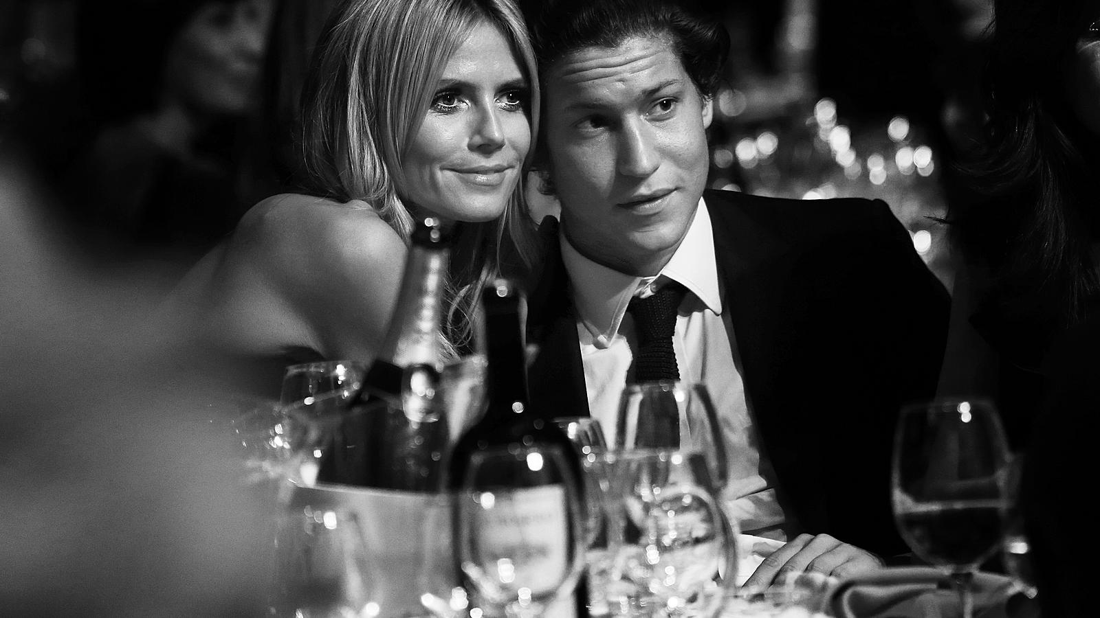 MILAN, ITALY - SEPTEMBER 20:  (EDITORS NOTE: This image was processed using digital filters) An alternative view of Heidi Klum and Vito Schnabel  at amfAR's Milano 2014  duirng the Milan Fashion Week Womenswear Spring/Summer 2015 on September 20, 201