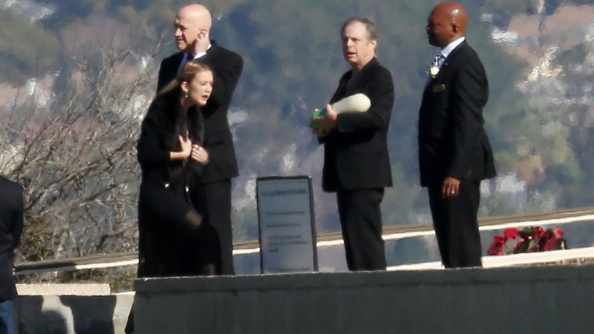 Todd Fisher leads the family and friends into the funeral at Forest Lawn Drive for Carrie Fisher and Debbie Reynolds.
