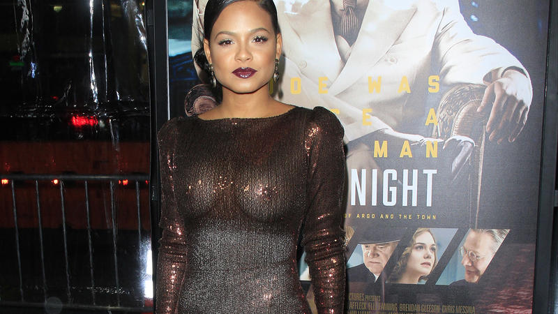 Christina Milian wears a very see through dress without underwear at the premiere of 'Live by Night' in Hollywood, CA. The flashes of the photographers even expose the spanx she wears underneath.