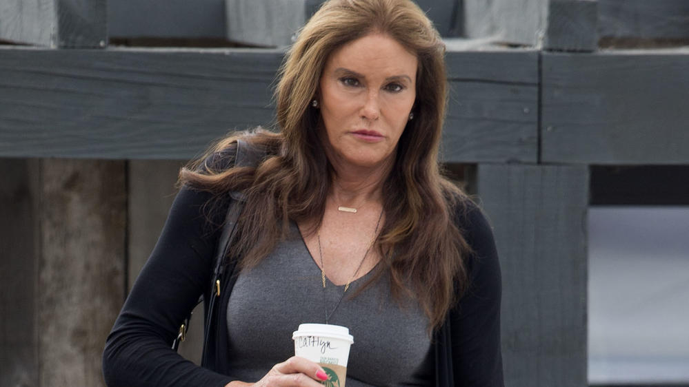 Caitlyn Jenner picks up coffee at 'Starbucks' in Malibu, CA.   The reality tv star forthcoming memoir, makes claims that Robert Kardashian told her he believed O J Simpson was guilty of Nicole Brown Simpson and Ronald Goldman.  Caitlyn wore a long gr