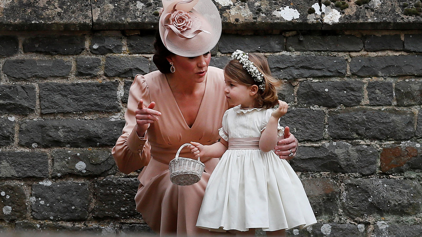 Britain's Catherine, Duchess of Cambridge stands with her daughter Princess Charlotte, a bridesmaid, following the wedding of her sister Pippa Middleton to James Matthews at St Mark's Church in Englefield, west of London, on May 20, 2017.    REUTERS/
